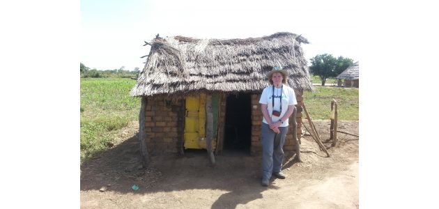 Fiona outside a latrine in Bobol Village