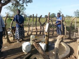 Locals using the pump in Bobol Village
