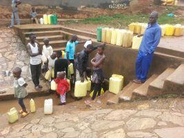 Children collecting free but contaminated water in the slums