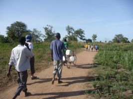 Returning with safe water from the pump provided by WaterAid in Bobol Village